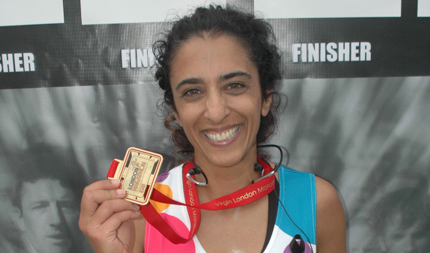 Kavita with her medal for the London Marathon