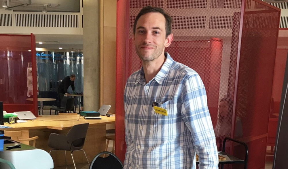 Gareth Parker standing in the foyer of Guy's Cancer Centre in London