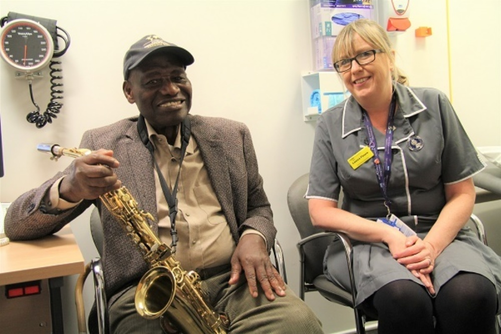 Rex the fundraiser musician with his muse, nurse Louisa