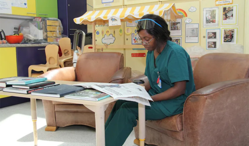 Staff member relaxing in the wellbeing zone