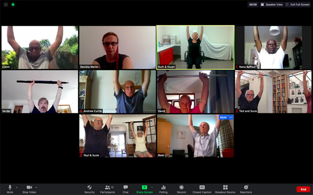 A screen shot of a video chat with 10 participants doing exercise from home