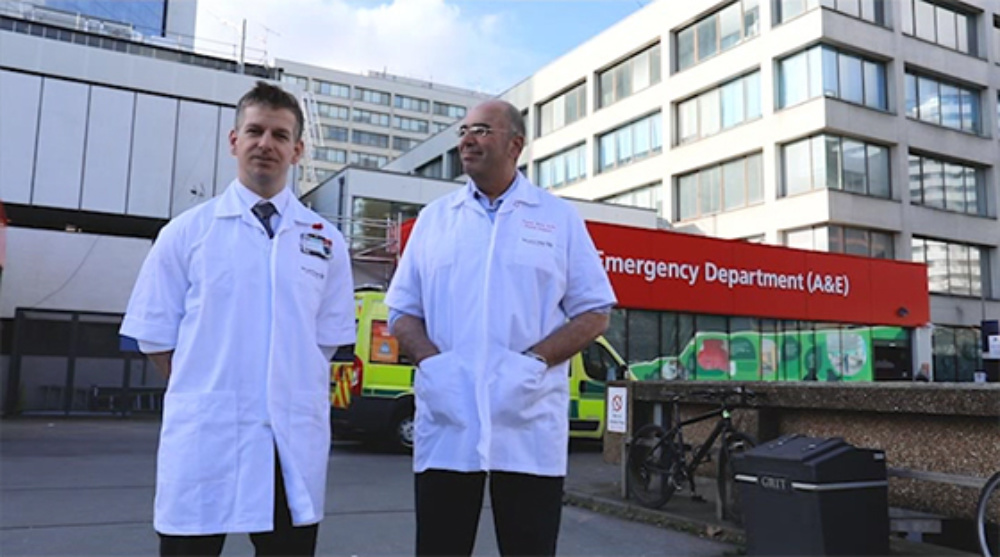 Two clinicians stood outside Guy's hospital in London Bridge