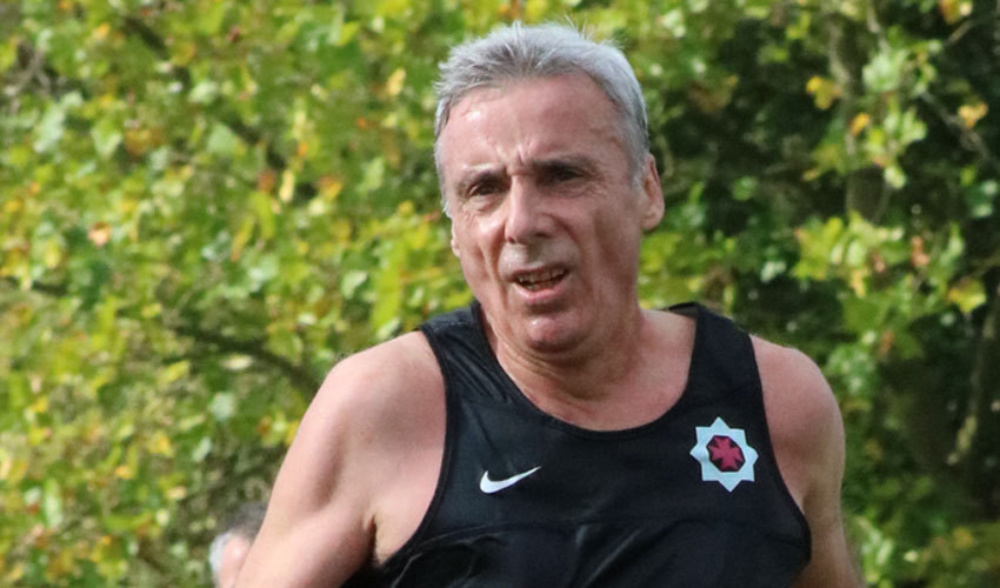 Close up of man in sports gear, running through the park