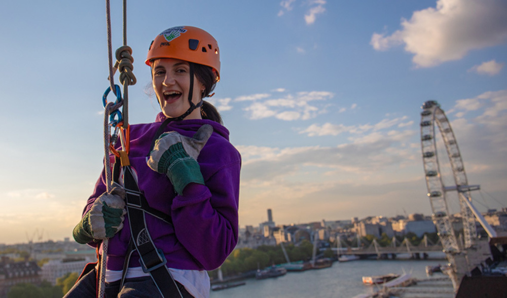 Lauren, 2019 participant abseiling under the setting sun