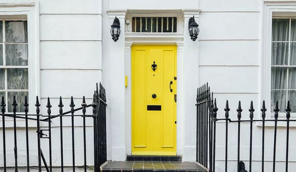 Yellow front door of a white town house